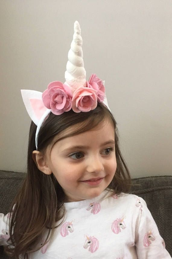 Rose Unicorn headband for all of the Unicorn lovers! 2-4 weeks turnaround For the hard headband option I would suggest 18 months and up. Both models are wearing the hard headband option. This listing is for one hard ribbon wrapped headband with a soft stuffed off white lace Unicorn