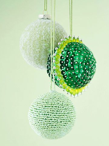 Green with Envy: These stylish green ornaments prove that not all that glitters is gold. Silver pinheads bring metallic flair to the sequin-covered sphere. Use pins to attach sequins to a foam ball, overlapping the sequins slightly and continuing until the sphere is covered. Create the beaded beauty by stringing beads into long strands. Glue the strands in a spiral around a papier-mache ball that has been painted the same color as the beads.