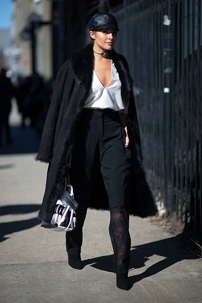 d4812052483 Olivia Culpo is wearing Public school top and pants Eugenia Kim hat and  Giuseppe shoes in the streets of Manhattan during New York Fashion Week.