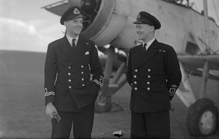 THE AIRCRAFT CARRIER HMS CHASER'S U-BOAT SUCCESS. 11 MARCH 1944, DONIBRISTLE. MEN OF THE CHASER'S FAIREY SWORDFISH SQUADRON WHICH DESTROYED 2 U-BOATS DURING A RECENT ACTION./ Two of the Fairey Swordfish pilots who took part in the successful action against the U-boats next to one of their machines. Lieut Cdr (A) F C Nottingham, DSC, RNVR, of Johannesburg, South Africa, the Squadron Leader (right) with Lieut (A) E B Bennett, RNVR, of Southend. © IWM (A 22281)