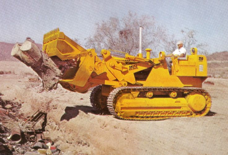 International Harvester also made a dedicated track loader version of the TD-20B called the 250B. Normally equipped with a Drott 4-in-1 bucket, this example is mulching out on tree stumps. The 250B was popular with demolition contractors who considered them pretty bullet-proof.