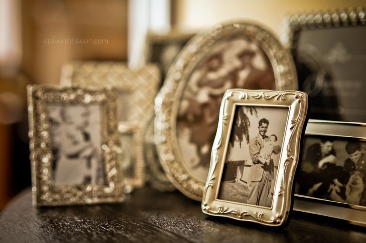 old photos in silver frames.