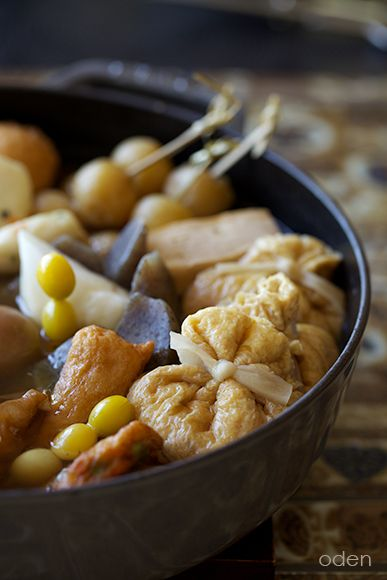 おでん Oden - Japanese winter dish consisting of several ingredients such as boiled eggs, daikon radish, konnyaku, and processed fish cakes stewed in a light, soy-flavoured dashi broth. おでん
