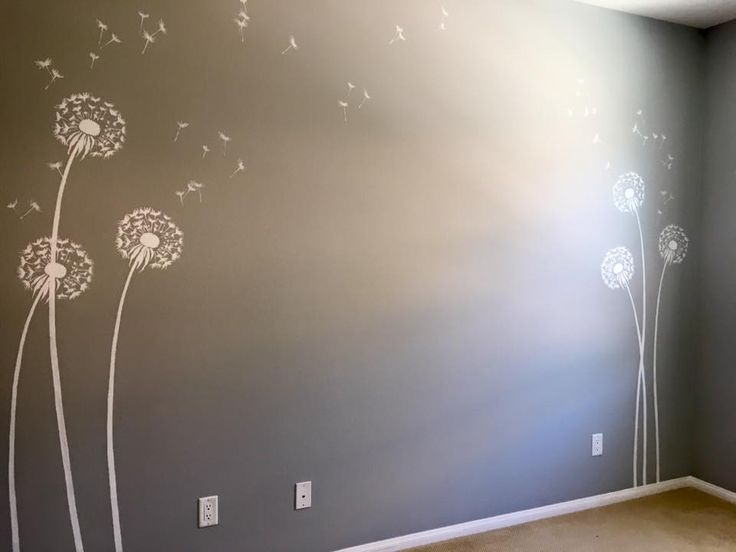 A DIY stenciled nursery accent wall using the Dandelion Stencil from Cutting Edge Stencils. http://www.cuttingedgestencils.com/dandelion-stencil.html