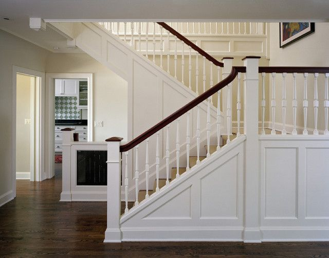 Craftsman or Mission style staircase.  Knee wall, white and stained wood