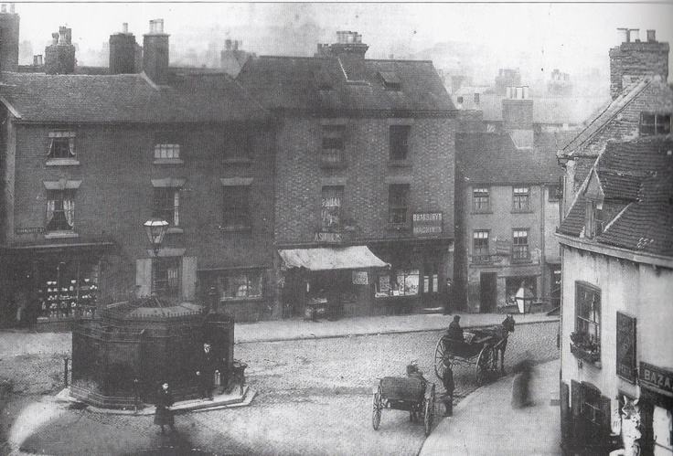 Charlotte Street, Nottingham, at the end of the 19th century. The building in the centre of the road is a public urinal.  Charlotte Street was one of many streets demolished to make way for Nottingham Victoria railway station, which was demolished after just 67 years in use to make way for the Nottingham Victoria Shopping Centre.