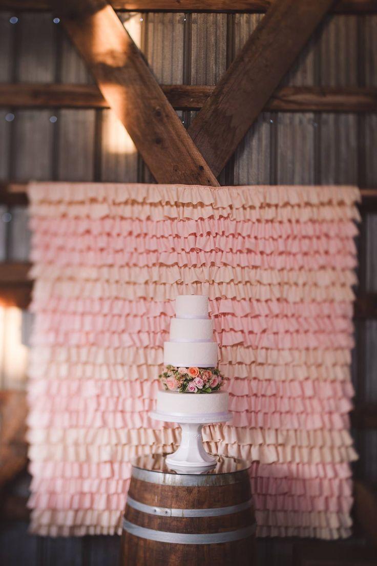 #weddingcake #cake #florals #backdrop #peach #pink #white #winebarrel #barn #wedding #barn wedding #okanagan #barnreception #reception #marque #love #lace #chandeliers #parasols #bunting #rustic #barnwood https://www.facebook.com/silversagestables