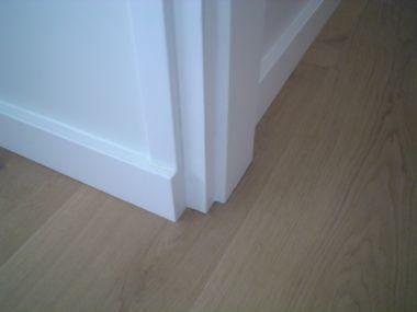 Vloerovergang houten planken naar tegels/deurkozijnen