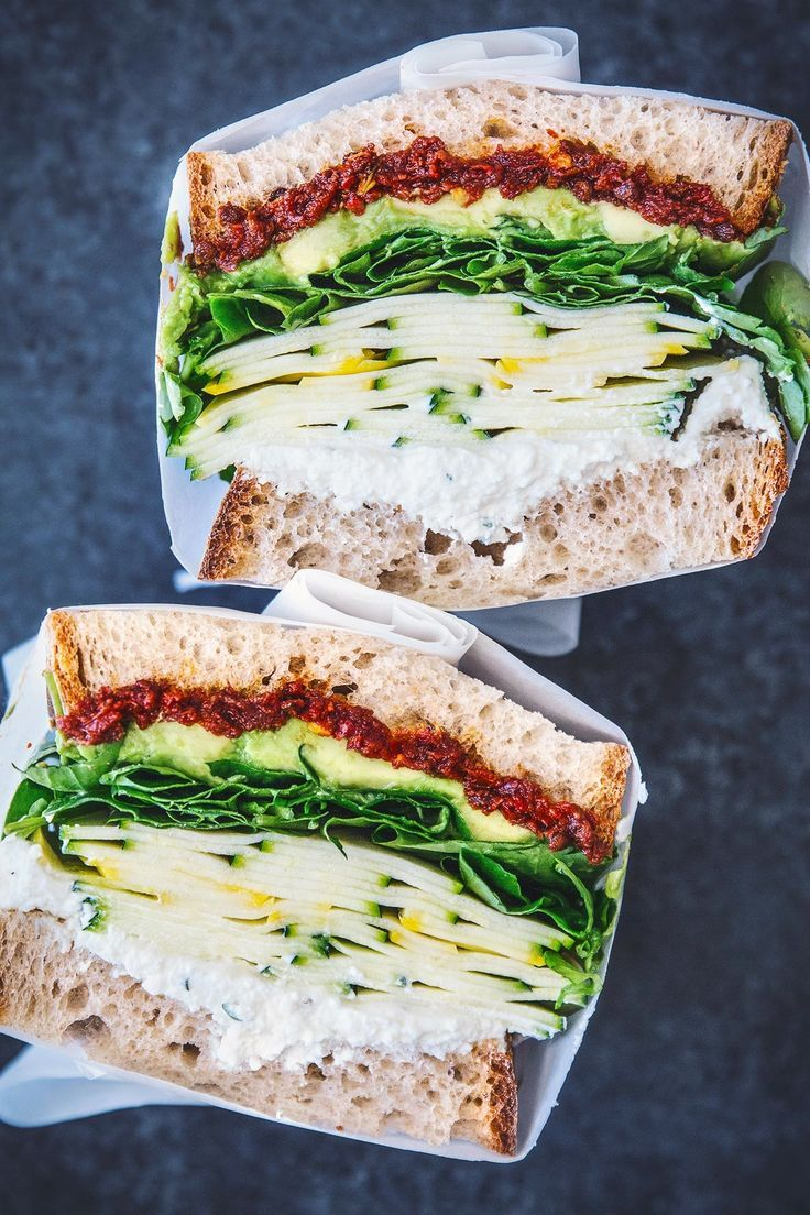 Looking for an exciting new lunch to bring to the office? One you'll actually want to eat instead of ordering takeout? Need a picnic- or beach-friendly midday meal option? Between the spicy sun-dried tomato spread, crunchy ribbons of zucchini and yellow squash, creamy avocado and ricotta, and crispy watercress, I'd say this sandwich definitely nails it.