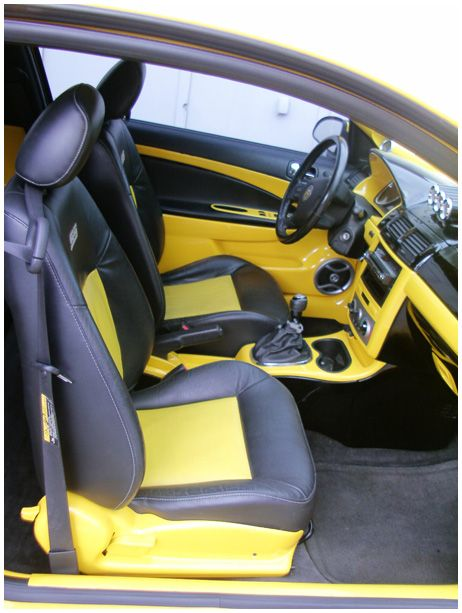 2006 Chevy Cobalt SS Supercharged yellow and black interior door panels console dash seats