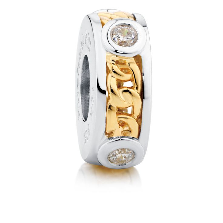 Stylish and sophisticated, this stunning cubic zirconia charm in 10ct gold and sterling silver will make the perfect addition to your bracelet. Exclusive to Emma & Roe.