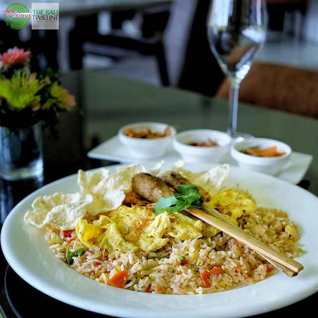 """Food Blog Bali  #Food: Balinese Fried Rice #Delicious: 3.5/5 #Foodcious: calling to all """"nasi goreng"""" lover to add collection to your fried rice list this Balinese version that you should try  Served with satay lilit shredded chicken egg & crackers.    @theparlourbali  Rp 60k  Jl. Petitenget #seminyak    #NasiGoreng #FriedRice #amazingindonesiafood #FeastIndonesia #acmi"""