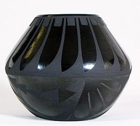 SOUTHWESTERN: San Ildefonso Pueblo, Maria Martinez Pottery. Mid 20th century. Maria discovered that smothering the fire surrounding the pottery during the firing process caused the smoke to be trapped. The carbon in the smoke caused the pottery to turn to a black ash color. Martinez passed on her knowledge and skill to many others including her family, women in the pueblo, and students.