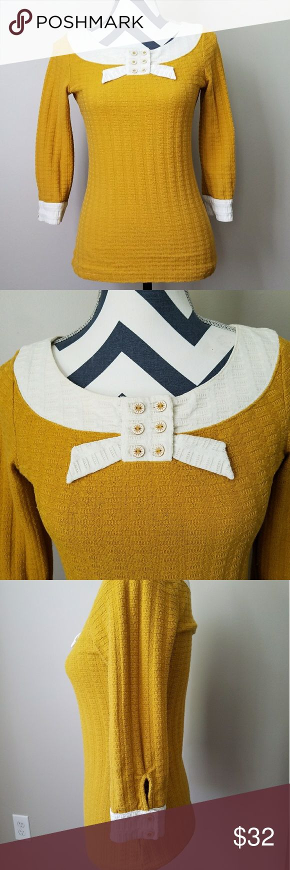 """Pilcro and the Letterman mustard colored top This textured, 3/4 sleeve, mustard and ivory, cotton polyester blend, knit top by Pilcro and the Letterpress from Anthropologie is too cute! Size small and I'd say it'd best fit sizes 2 - 4..material does stretch. Underarm measurement is 16"""" and total length is approx 24"""" long. Excellent gently used condition! Anthropologie Tops"""