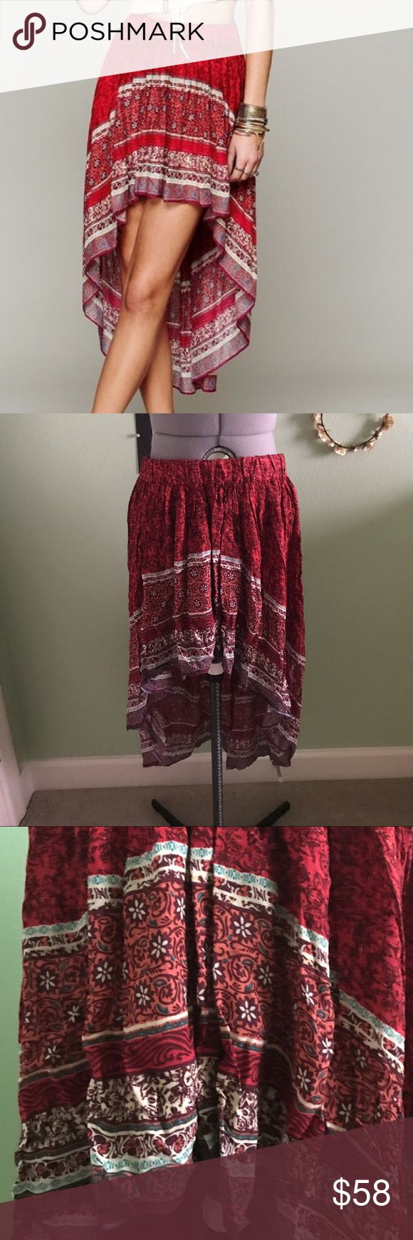 Free People Border Print High Low Slip Skirt Free People border print high low slip skirt. Crimson or red color with popping blue details. Gorgeous patterns and high low style. Size medium, but would sit on the hips of a size small. Worn once. Let me know if you have any questions! Free People Skirts High Low