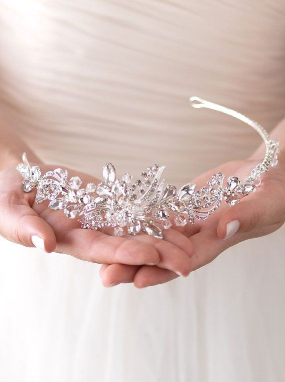 BLACK FRIDAY SALE! Enjoy 30% off our entire shop! Use coupon code BLACKFRIDAY at checkout. Valid through Monday November 28 at 11:59pm EST.   Lucy Crystal & Rhinestone Headband is perfect for the bride that is looking to add a little glamour and sparkle to her wedding day style. Wedding headpiece features marquise and oval shaped rhinestones accented with Swarovski crystals and smaller round stones in an elegant pattern that is concentrated on one side. The ornamented portion of this…
