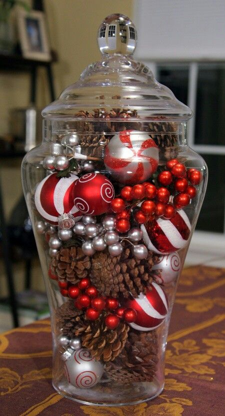 put pinecones in a jar with christmas ornaments for an easy decoration.