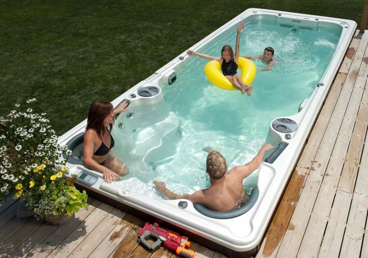 Is it a pool? Or is it a hot tub? Can you use it all year? Can you swim against a current? Can you install this in the ground or above ground?  The answer is YES!  Big swimspa sale this month!  Call us for more info 9058294991
