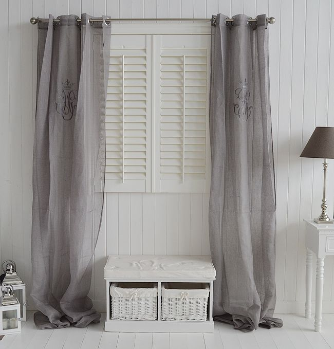 Grey voile line curtains with in a white hall from The