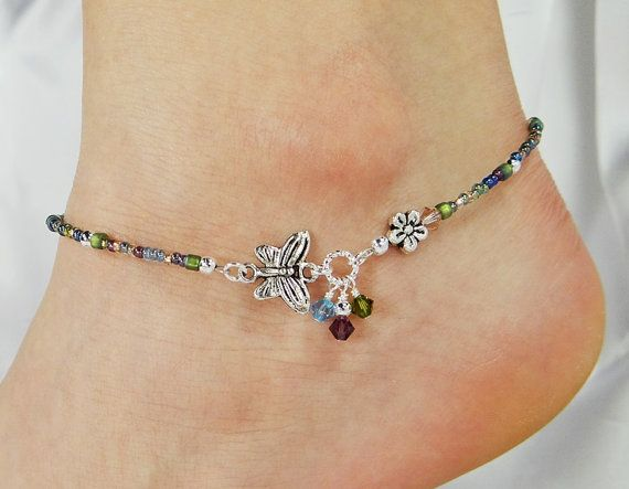 Anklet ankle bracelet made with a side silver pewter butterfly flying towards a silver pewter flower with colorful Swarovski crystal dangle