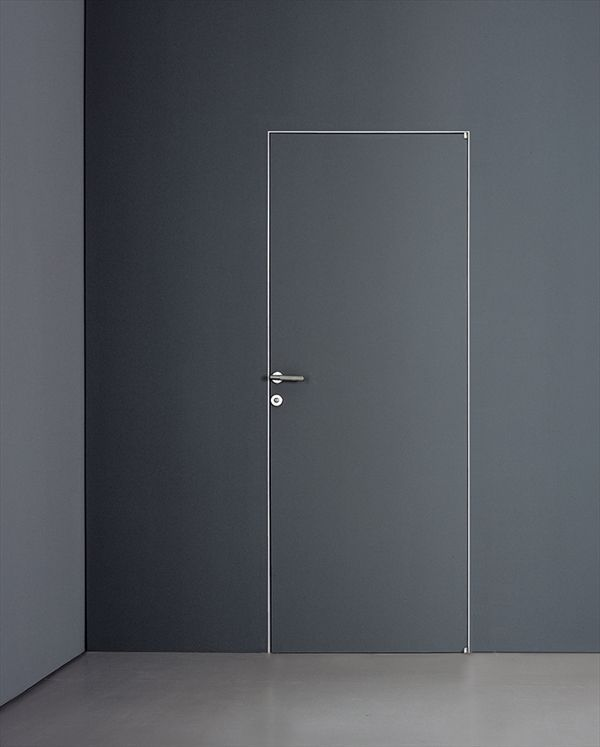 Wow! Love the minimalist approach to this wall and door...