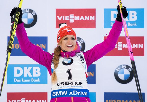 Gabriela Koukalova of Czech Republic celebrates on the podium after winning the women's 7,5 km sprint event of the IBU Biathlon World Cup in Oberhof, eastern Germany, on January 6, 2017. / AFP / ROBERT MICHAEL