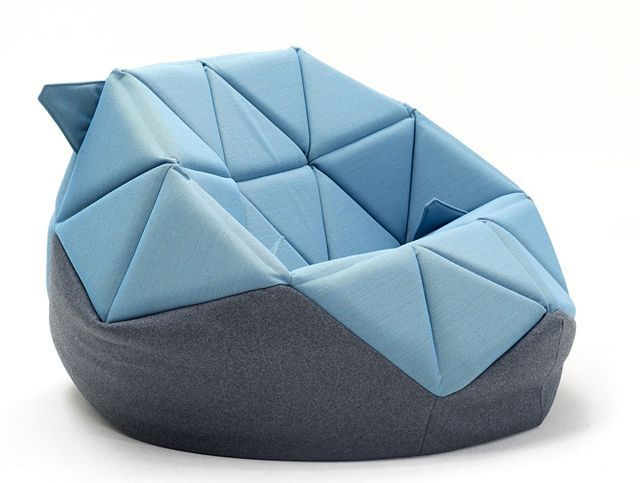Antoinnete Bader updates the bean bag by adding triangular leather pads on its upper half, providing a classier look and making it adaptable to various sitting positions. #BeanBagChair