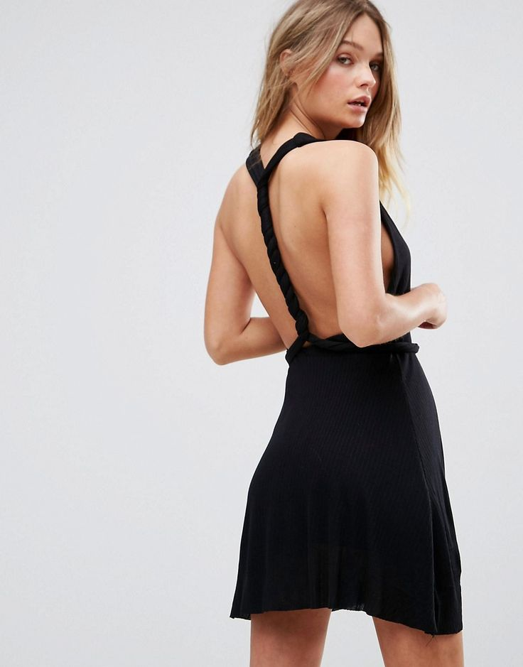 Buy it now. Pull&Bear Twist Back Detail Sundress - Black. Dress by Pull Bear, Lightweight woven fabric, Plunge neck, Tie front, Twist back detail, Regular fit - true to size, Machine wash, 100% Polyester, Our model wears a UK S/EU S/US S and is 170cm/5'7 tall. Born in the 90s, Pull Bear aren�t ones to suffer stereotypes. With a big nod to street style, Pull Bear go for an androgynous look, adding grunge influences and cool, sportier elements across a laidback and easy-wearing collection of…