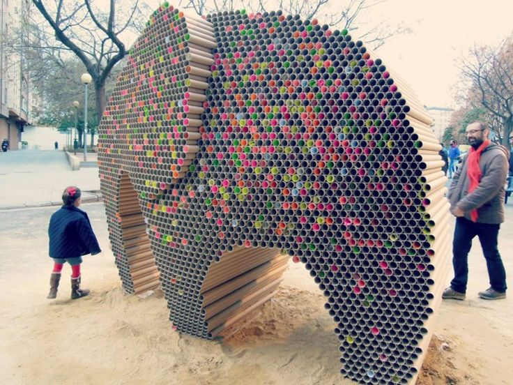The creative crew Nituniyo (Spanish creative agency) built this elephant sculpture out of 6000 recycled cardboard tubes for the Fallas Festival in Valencia (Spain). Over the duration of the festival, the sculpture slowly transformed from a cardboard brown into a colorful elephant with the participan…