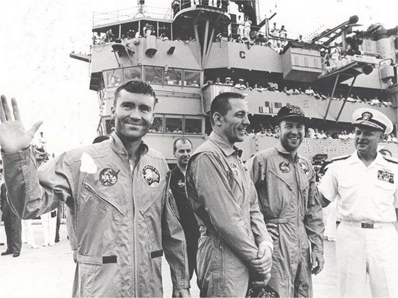The crew of Apollo 13 -- Fred Haise, Jack Swigert and Jim Lovell -- after they splashed down safely.   http://www.universetoday.com/62339/13-things-that-saved-apollo-13/