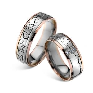 Modele verighete CORIOLAN V608    Verighete din aur alb si aur roz      Latime standard: 6.60 mm     Carate diamante: 0.06 Ct     Greutate aprox.: 13.8 gr/pereche     Timp de livrare: 2 saptamani Pretul este pentru o pereche de verighete din aur 14K cu diamant si este variabil in functie de marimi. Modelul poate fi comandat pe culorile dorite, deasemenea si in aur de 18K.