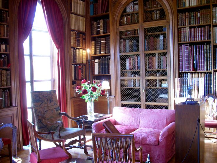 Home Library Design with Vintage Wooden Bookshelves in the All Interior Side of Vintage Armchairs Ideas and Cute Pink Set Sofa Furniture for Interior also Wooden Floor Brown