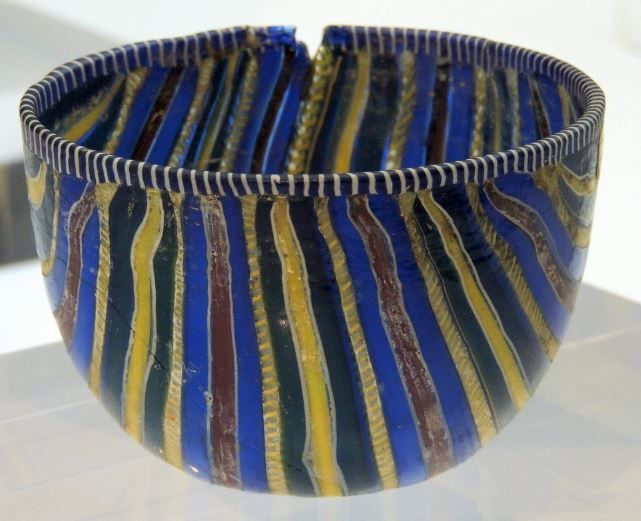 Roman striped millefiori cup, 1st century A.D. This is a type of mosaic glassware characterized by a distinctive flower-like pattern, the technique was invented by the Egyptians and was known to be used by Alexandrian craftsmen to create beads, 6.6 cm high. National Archaeological Museum, Florence