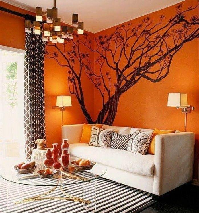 4couleur-peinture-salon-orange-avec-un-joli-sticker-mural-arbre-canapé-blanc-cassé-tapis-en-noir-et-blanc-table-à-café-en-verre-design-original-e1473499873237.jpg (699×750)