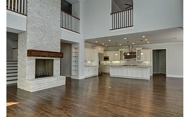 Great open floor plan! Love the two-story fireplace and openness to the second floor, very airy