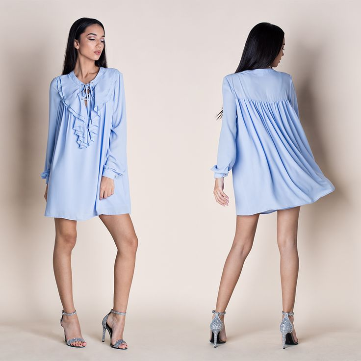 OVER THE EDGE BOHO MINI DRESS ---Perfect for parties, this boho-cool mini dress with criss-cross strings and cascading front ruffles it is soft and airy, perfect for a comfy look all the way. Break the rules with over-the- knee socks and platform sandals. Party in style! - Relaxed fit - Long sleeves - Buttoned cuffs - V-neckline with criss-cross strings - Front ruffles - Asymmetric - Back pleats