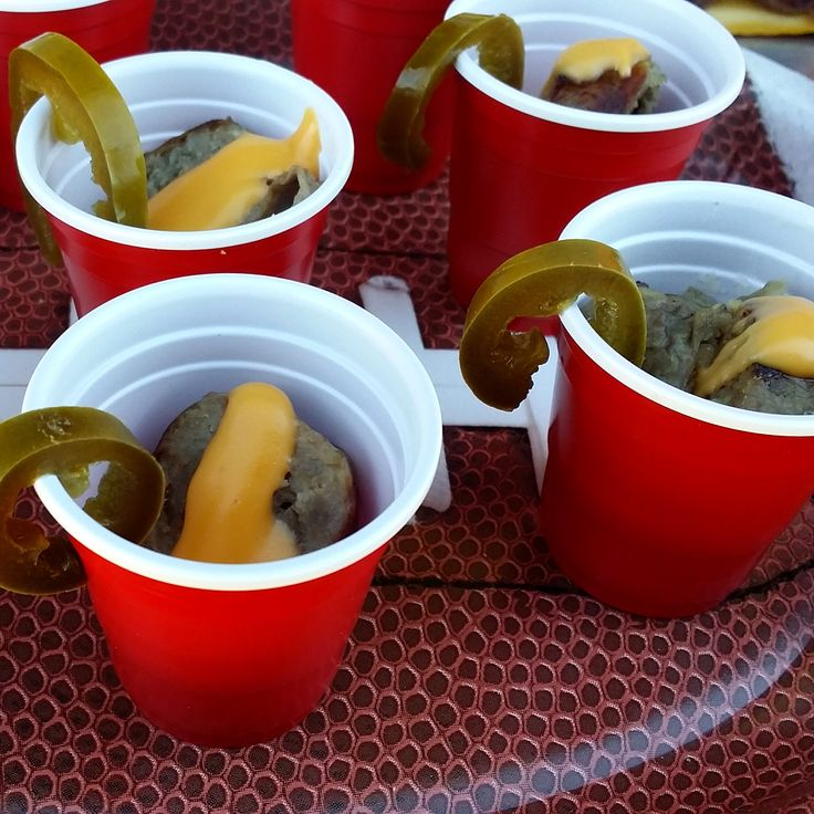 We love this #bratshot! #Grillmaster Ry, fearless commander of the #Johnsonville #BigTasteGrill, sent this snapshot from the road: A #RedSoloCup shot glass w/crushed Doritos, a brat slice, Cheez Whiz drizzle & jalapeno garnish! For a variation, try it w/any chip, sauerkraut & mustard! Genius idea for your #GameDay #football party!