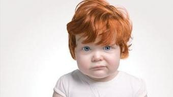 the smirk, on a little ginger baby's face