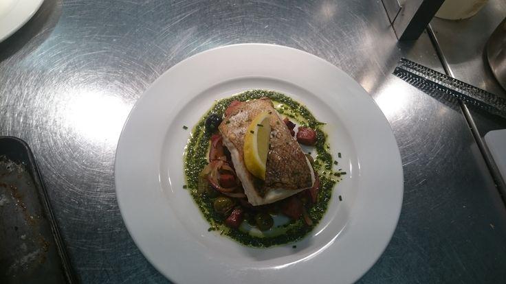 Pan seared cod on chorizo mixed olives , onions and basil pesto