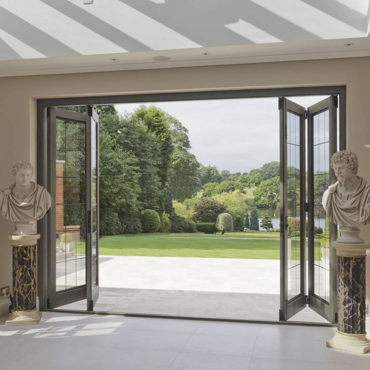 Bi-folding Timber Doors with Bronze Inserts : Puertas de Architectural Bronze Ltd