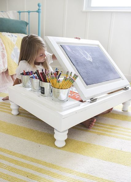 Surprise! The lid on this desk used to be the door of a cabinet. Now it's a fun chalkboard surface with feet that lift the desk off of the floor just enough for little ones to slip their legs under.