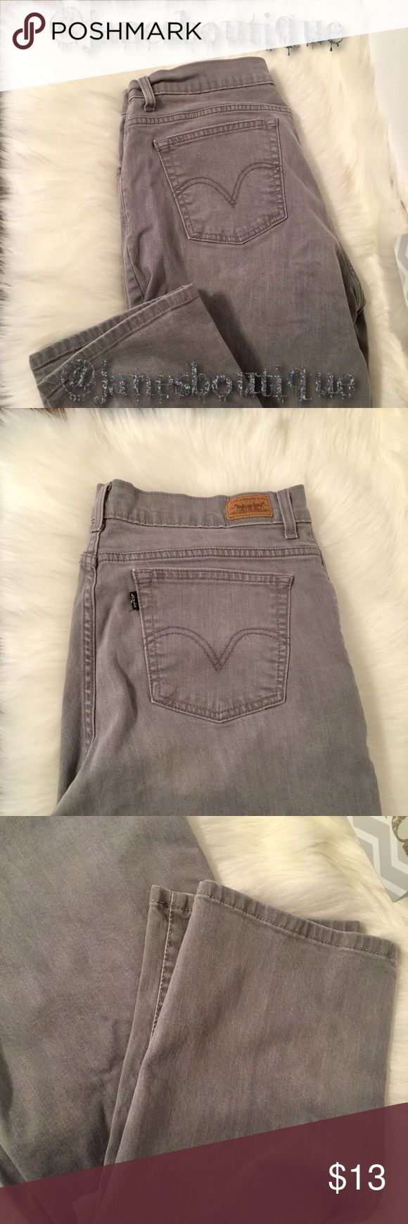 •Levi 550 Relaxed Tapered Jeans• Levi's 550 Gray wash Tapered jeans in size 16. Good used condition no stains, holes or rips. Levi's Jeans