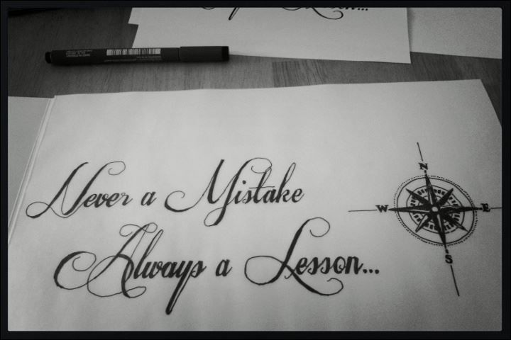 'Never a Mistake Always a Lesson' quote with Compass tattoo; to me it means life takes you in different directions, focus on what's to come, not the past.