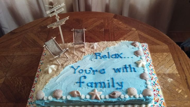 Beach-themed family reunion cake. A 9x13 vanilla side by side with a 9x13 chocolate. Vanilla wafer cookie crumbs for sand and chocolate molded seashells for accents. Beach chairs were made from Popsicle sticks, skewers and wide ribbon.