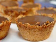 coconut tarts with choc and coconut cream! yumm, I am making this dessert as soon as possible.