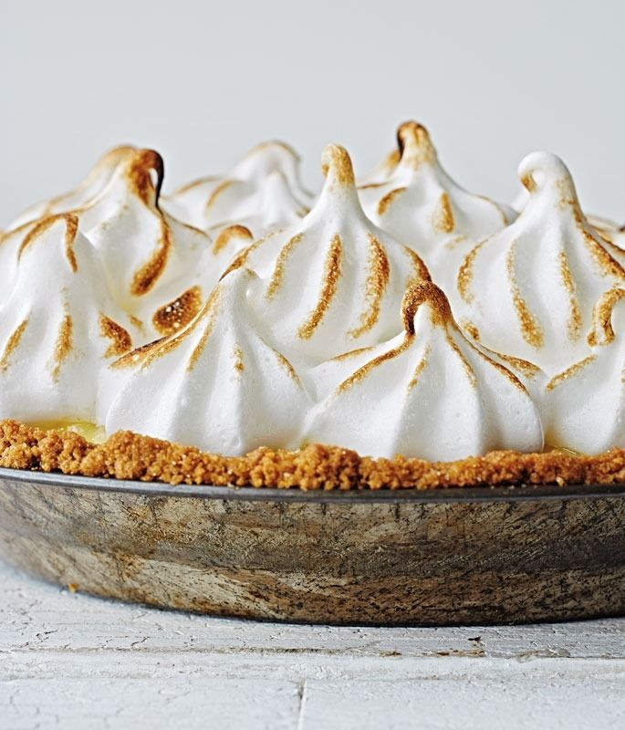 Lemon Meringue Pie with Gingersnap Crust | A tangy-sweet lemon meringue pie piled high with billowy, light-as-a-feather meringue. Here we call for Meyer lemons, which add a sweet, floral note.