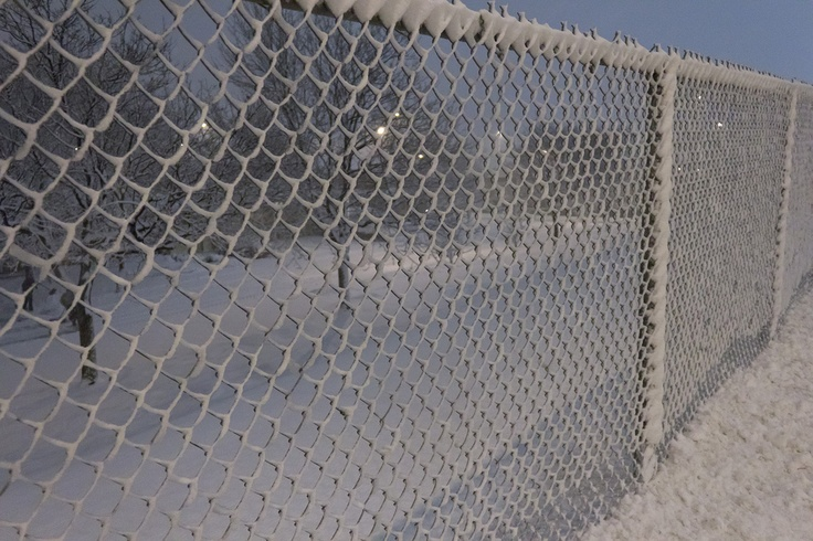 #snow covered chain fence.