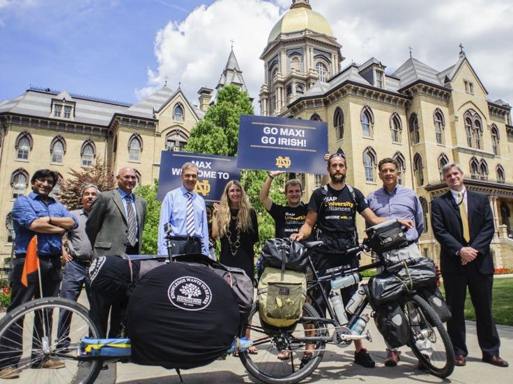 Max Peer stops at the University of Notre Dame during his bicycle trip around the world