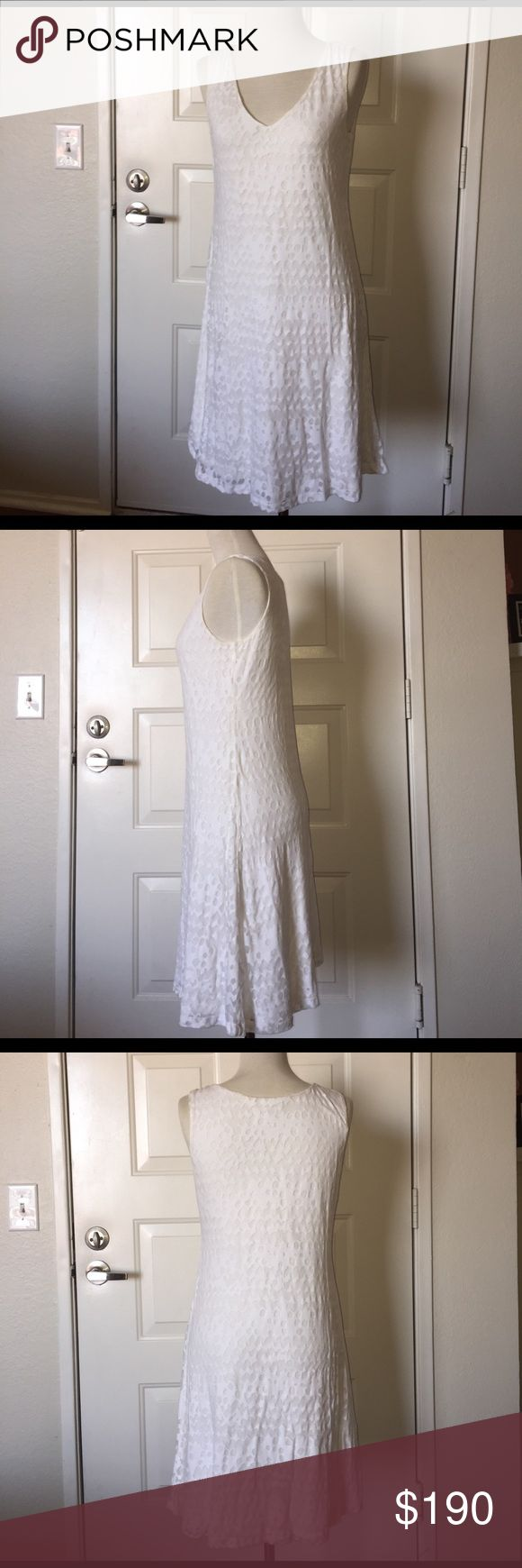 Calvin Klein NWOTwhite dress This sweet dress is perfect for Easter Sunday or bridal showers, perfect condition only ever bought and sat in a closet because I can't wear white without spilling on it so there are no stains or signs of wear since I was always too scared to wear it 😅 Calvin Klein Dresses Midi