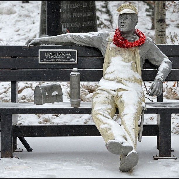 The Lunch Break sculpture in Churchill Square had some added colour on a cold dreary January day in Edmonton, Alberta, Canada. Photo by John Lucas/Edmonton Journal
